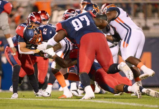 Apollos running back D'Ernest Johnson (22) plows into the end zone for a first-quarter touchdown Saturday.