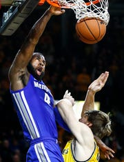 Memphis forward Raynere Thornton (left) finishes a dunk while being fouled by Wichita State's Asbjorn Midtgaard on Saturday.