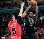 Bucks forward Khris Middleton shoots over Bulls guard Zach LaVine during a game at the United Center in Chicago earlier this month. The teams meet again in Chicago on Monday.