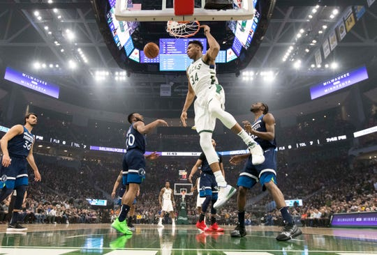 Bucks forward Giannis Antetokounmpo dunks against the Timberwolves on Saturday night at Fiserv Forum. Antetokounmpo finished with 27 points, 10 rebounds and seven assists.