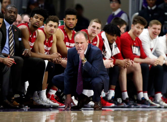 Wisconsin head coach Greg Gard studies the action during the second half of the Badgers' game against Northwestern on Saturday.