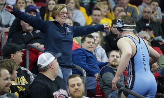 Nicolet's Parker Keckeisen goes to give his mother, Lynne, a hug after his 19-4 win over Menomonie's Sam Skillings in the final of 182 pounds in Division 1.