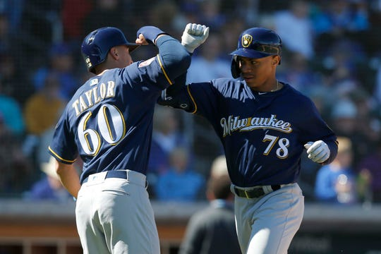 Brewers centerfielder Corey Ray celebrates with Tyrone Taylor after hitting a two run home run in the second inning Saturday.