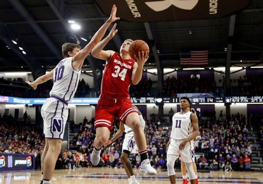 Wisconsin guard Brad Davison goes to the basket against Northwestern forward Miller Kopp.