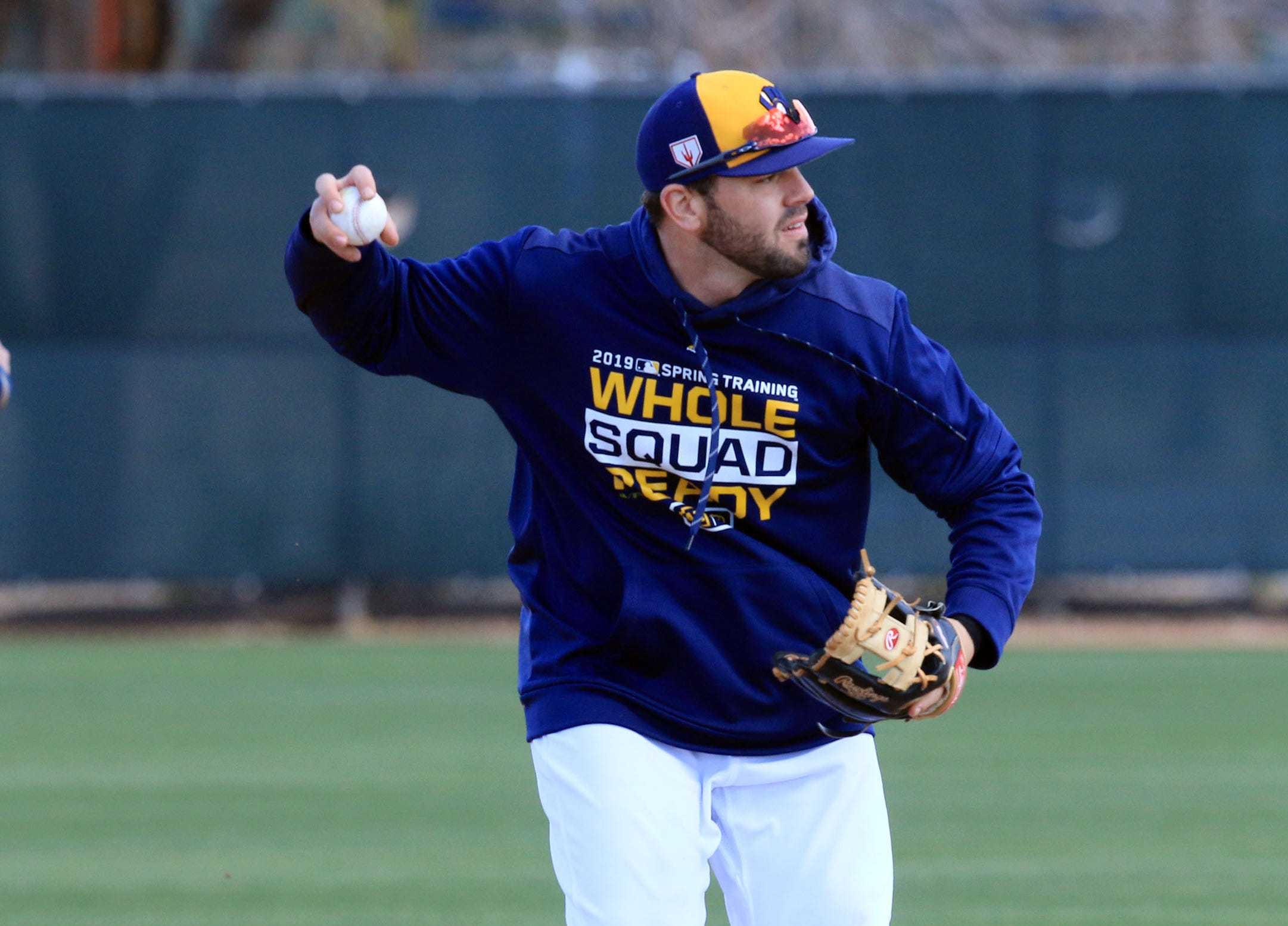 Mike Moustakas of the Milwaukee Brewers completes a double play, during spring training drills, Tuesday, February 19, in Phoenix, Arizona.(Photo/Roy Dabner) ORG XMIT: RD067
