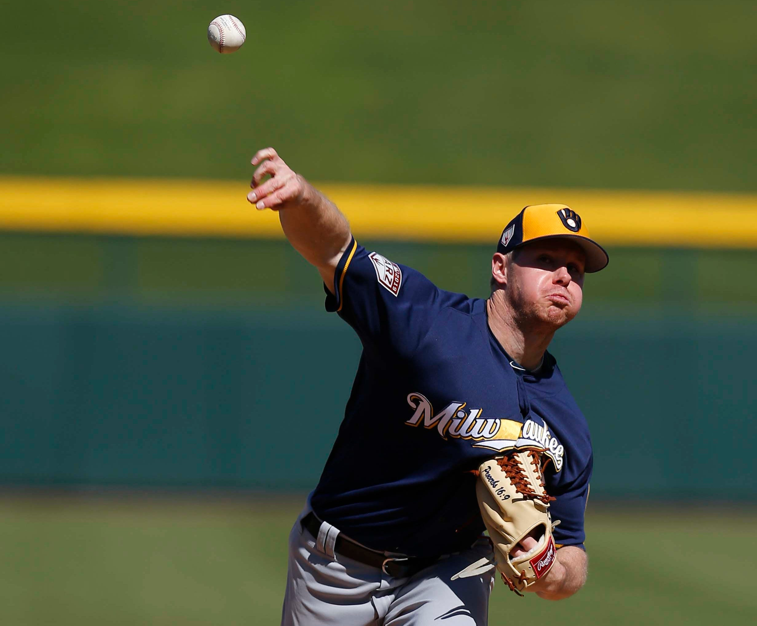 Brewers starting pitcher Chase Anderson gave up two runs, both coming on a homer by Kris Bryant, in his only inning of work against the Cubs in the teams' spring training opener Saturday.