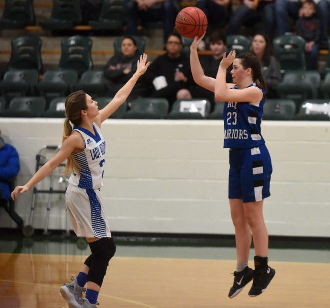 Cotter's Paige Clawson shoots a 3-pointer during the Lady Warriors' victory over Hector on Saturday.