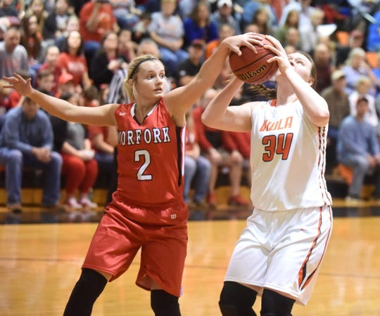 Norfork's Whitlee Layne (2) comes up with a block against Viola on Saturday. Layne recently moved into second place on the all-time girls' state career scoring list.