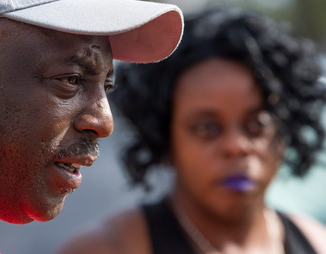 Kenneth Gunn and Kimberly Gunn, siblings of Greg Gunn, talk about their brother at a vigil for Greg Gunn in front of the Gunn family home in Montgomery, Ala. on Sunday February 24, 2019. Gunn was shot and killed by Montgomery police officer Aaron Cody Smith in February 2016.