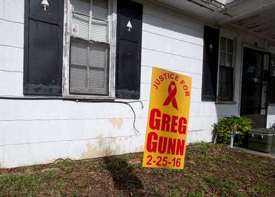 A sign marks the spot in front of his neighbor's house in Montgomery, Ala., where Greg Gunn was shot and killed by Montgomery police officer Aaron Cody Smith on February 25, 2016.