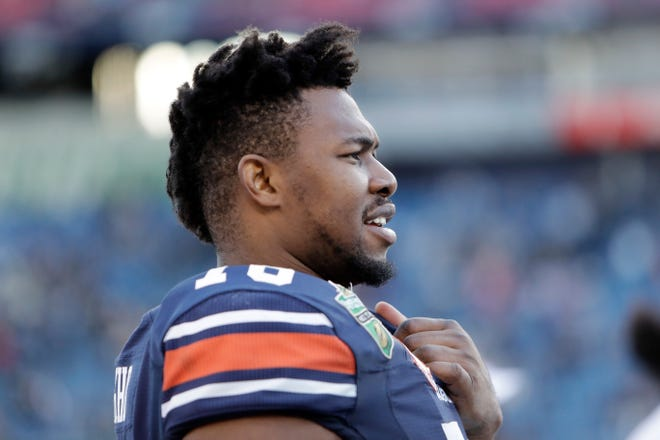 Auburn offensive lineman Prince Tega Wanogho watches from the sideline during the second half of the Music City Bowl against Purdue Friday, Dec. 28, 2018, in Nashville, Tenn. Auburn won 63-14.
