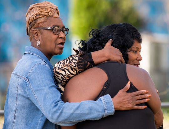 Kimberly Gunn, sister of Greg Gunn, is comforted by Catherine Wright, left, and Linda Tyson Thomas during a vigil for Greg Gunn in front of the Gunn family home in Montgomery, Ala. on Sunday February 24, 2019. Gunn was shot and killed by Montgomery police officer Aaron Cody Smith in February 2016.