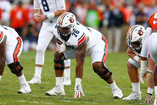 Auburn offensive lineman Prince Tega Wanogho (76) lines up during a game against the Clemson at Memorial Stadium on Sept. 9, 2017.