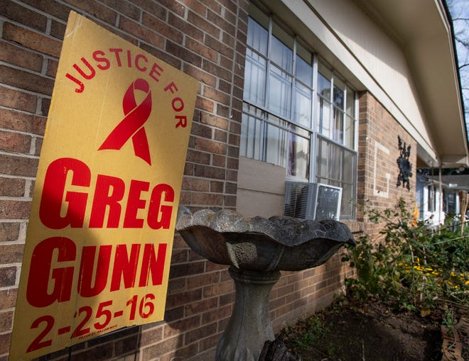 A sign in front of the Gunn family home during a vigil for Greg Gunn in Montgomery, Ala. on Sunday February 24, 2019. Gunn was shot and killed by Montgomery police officer Aaron Cody Smith in February 2016.