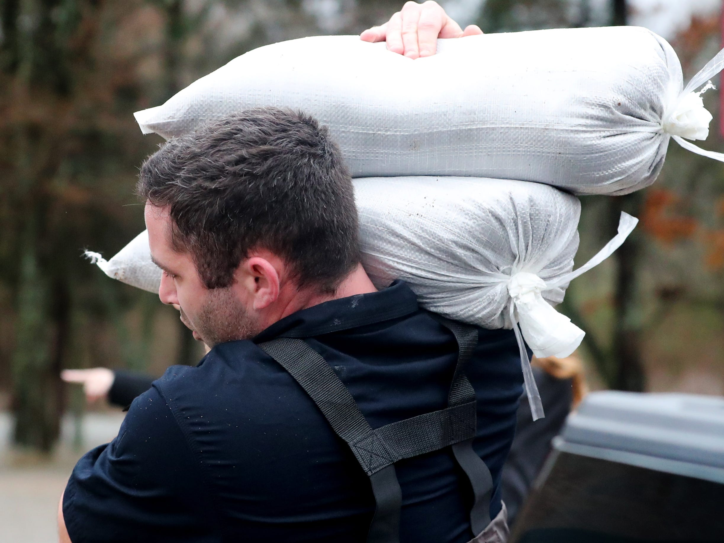 Christiana Fire Department members Allen Williams move  sand bags in Murfreesboro on Saturday, Feb. 23, 2019.