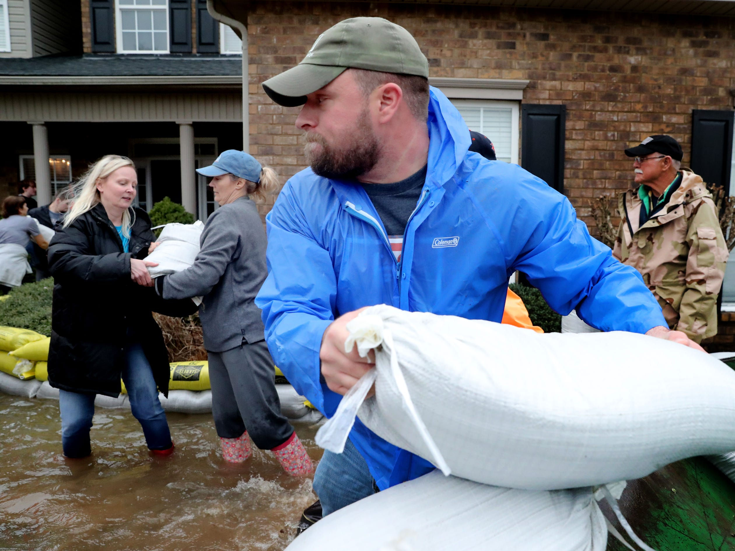Michael Derby helps out neighbors with sand bags during flooding in Murfreesboro on Saturday, Feb. 23, 2019.