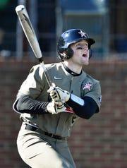 Vanderbilt catcher Philip Clarke (5) hits a home run during their game against Pepperdine at Hawkins Field Sunday, Feb. 24, 2019 in Nashville, Tenn.