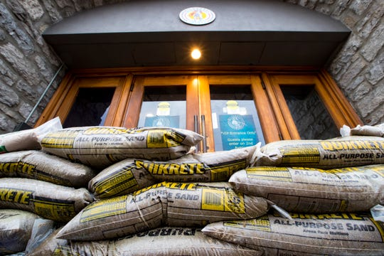 Sand bags block an entrance to the Wild Horse Saloon near the Cumberland River in Nashville on Sunday, Feb. 24, 2019.