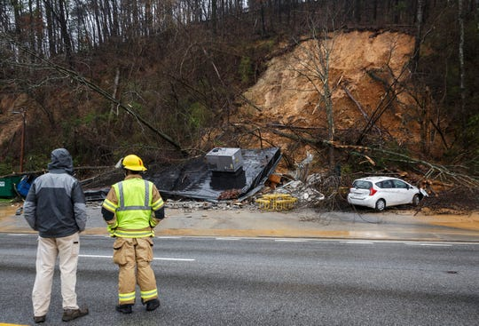 Emergency workers survey damage after an overnight mudslide destroyed a Subway restaurant on Signal Mountain Road in Chattanooga, Tenn., Saturday, Feb. 23, 2019. Subway manager Robbie Anderson said that the restaurant had closed at about 2:00 on Friday for safety after two trees fell from the hillside.