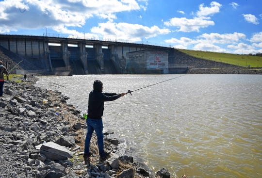 After days of record rainfall fishermen enjoy blue skies and sunny weather below the Percy Priest Dam in Hermitage Sunday, Feb. 24, 2019, in Nashville, Tenn.