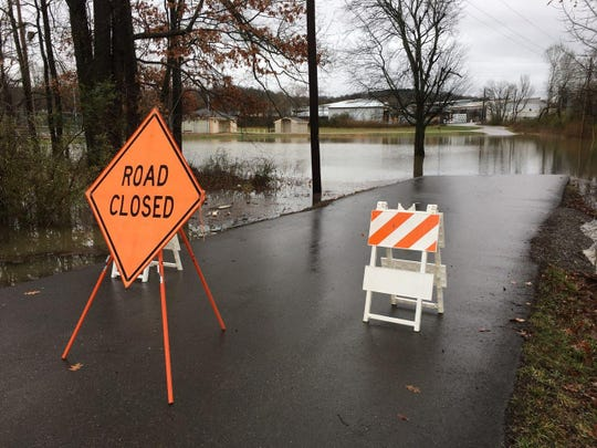 Hazard signs are placed in front of the Ashland City tennis courts on Saturday, Feb. 23, 2019, after days of rain hit Middle Tennessee.