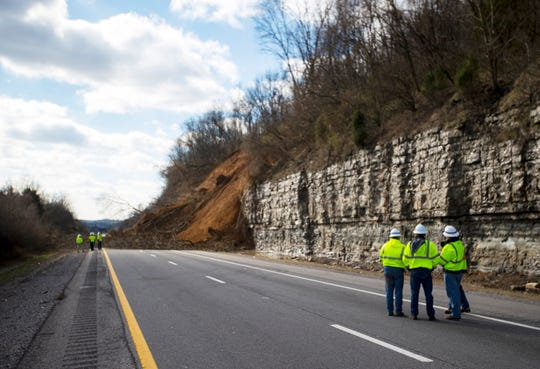 TDOT workers at the site of a landslide that closed the eastbound lanes of I-24 near Whites Creek on Sunday, Feb. 24, 2019.