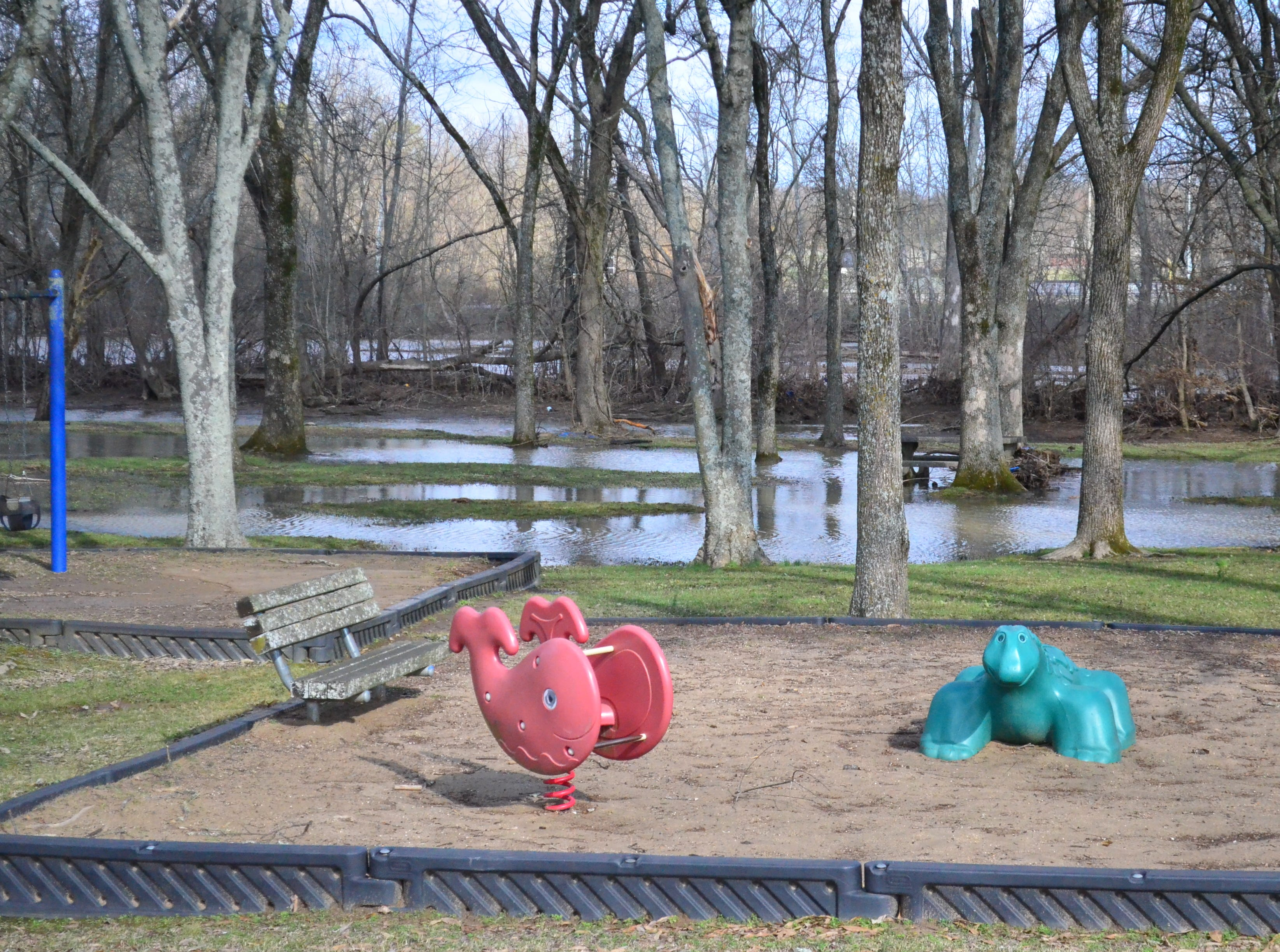 The playground at the front of Drakes Creek Park was flooded Sunday, Feb. 24, 2019.