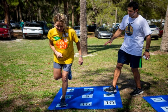 Deborah Kuettel, left, helps Nino Magaddino, right, of Max Flex Fitness, with a cognitive fitness demonstration during the third annual SWFL Veg Fest at Riverside Park in Bonita Springs on Sunday, Feb. 24, 2019. Magaddino says that cognitive fitness will be the future of exercise and improving cognitive ability.