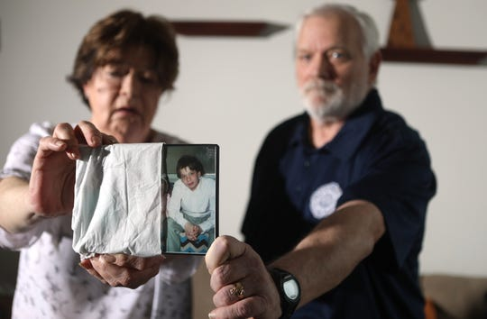 Ed and Phyllis Hanratty hold a photograph of their son.  The image was taken during the years (approximately 1986-1990) when he was being sexually abused by  Rev. Gerald Sudol of St. Francis of Assisi Church, in Ridgefield Park.  Their son was 10-14 years old at the time. Sunday, February 24, 2019