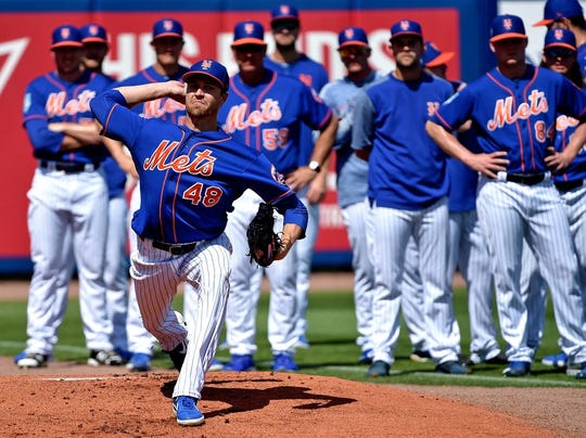 Feb 24, 2019; Port St. Lucie, FL, USA; New York Mets starting pitcher Jacob deGrom (48) warms up before a game against the Houston Astros at First Data Field.