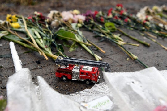 Mourners left flowers, toy cars, and a fire truck at the Delta gas station as funeral services take place for Jon and Luke Warbeck on Sunday, Feb. 24, 2019 in Wayne. Jon, a former firefighter, and his 17-year-old son Luke were killed when a drugged driver crashed into their car while at a Delta gas station on Route 23, also killing attendant Lovedeep Fatra.