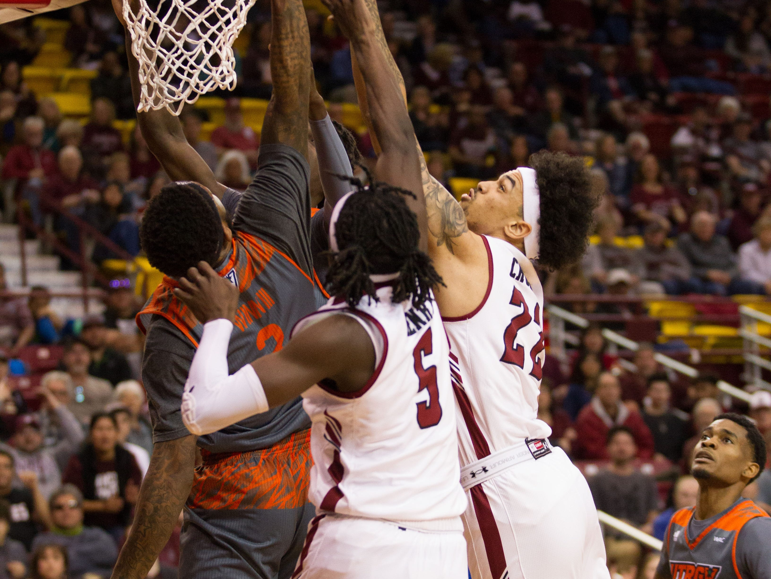 Eli Chuhu, 22 and Clayton Henry, 5, battle for the offensive rebound. The NMSU Aggies hosted UT Rio Grande Valley on February 23, 2019.