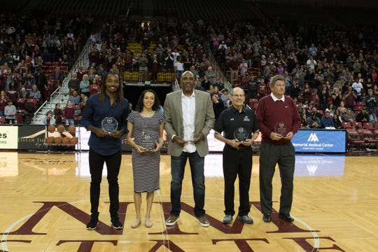 The newest NMSU Hall of Fame inductees, from left, Davon House (football), Krystal (Torres) Ceniceros (volleyball), Reggie Jordan (men's basketball),  Dr. Jack Welch (men's swimming) and Steve Haskins (men's golf).