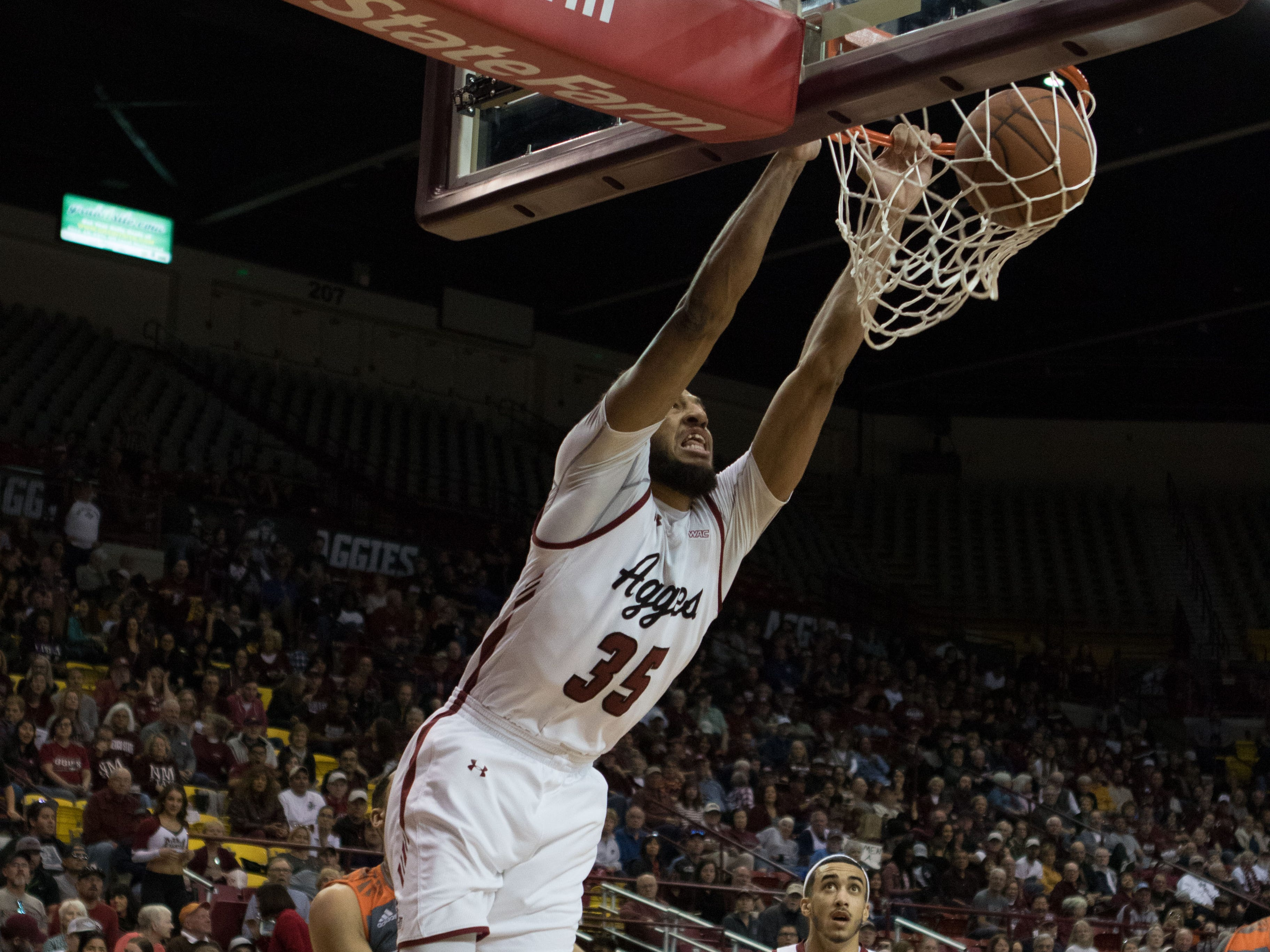 New Mexico Staet's Johnny McCants puts in one of his signature  dunks against Texas Rio Grande Valley on Saturday at the Pan American Center.