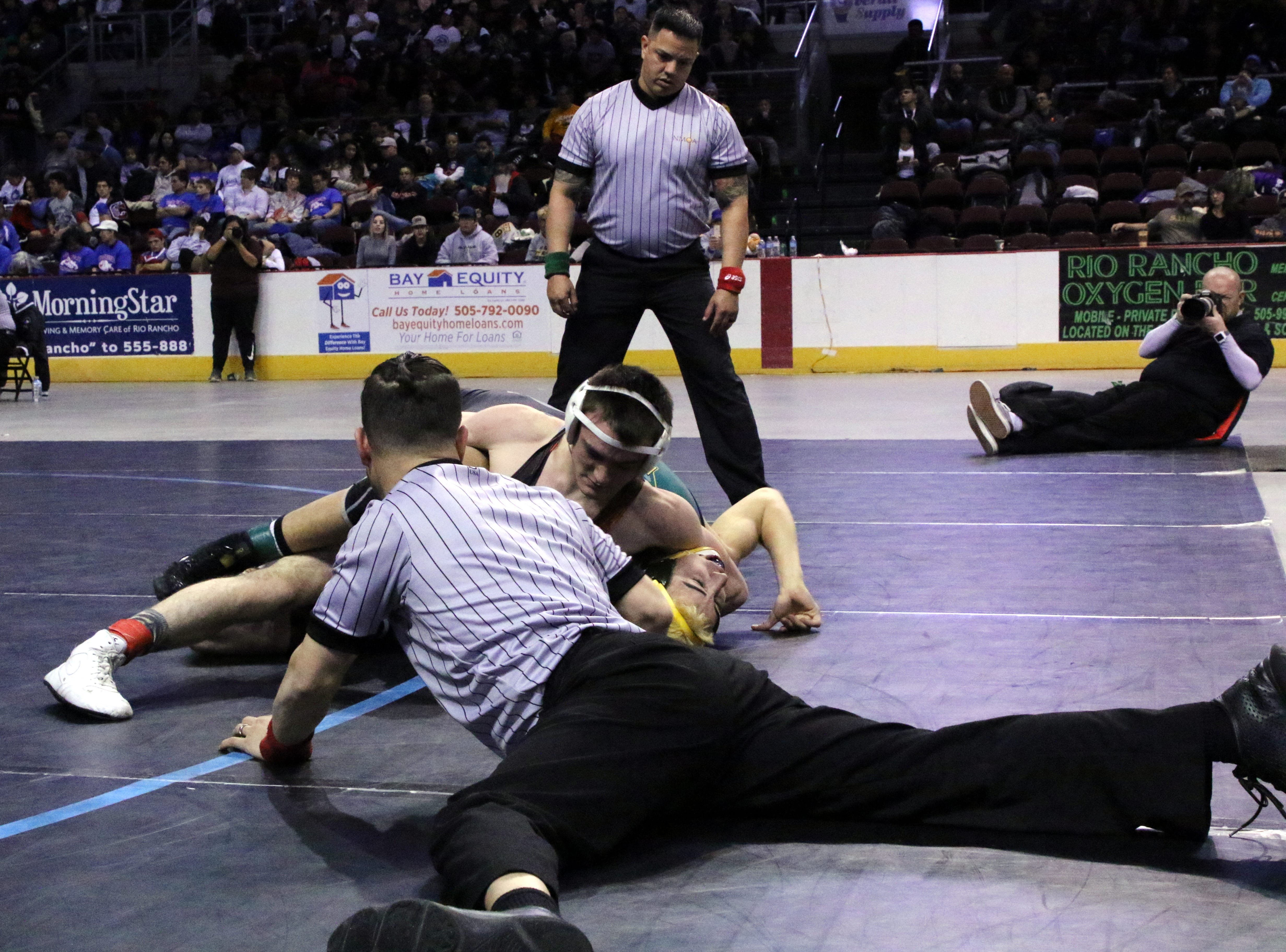 Aztec's Christian Robison works on a pinfall attempt during his championship match on Saturday.