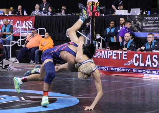 Deming's Marco Martinez drives his opponent to the mat during the Saturday portion of the 2019 NMAA State Wrestling Championships.