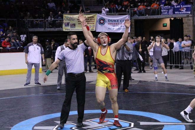 Centennial's Marco Rodriguez has his hand raised after winning the Class 5A 182-pound division. This was the first state wrestling title for Centennial in school history.