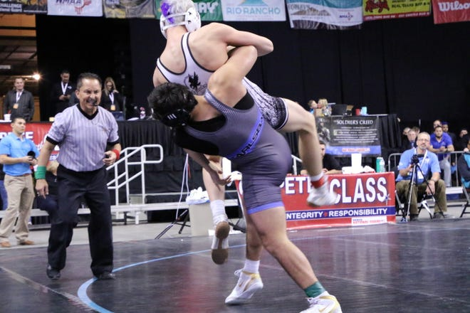 Carlsbad's Fabian Padilla slams his opponent to the mat during his championship match on Saturday.