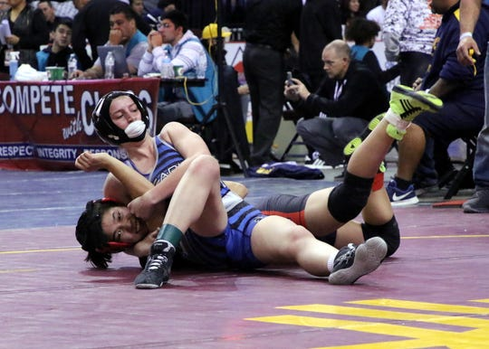 Carlsbad's Cady Box wrestles in the championship round during the Saturday portion of the 2019 NMAA State Wrestling Championships.