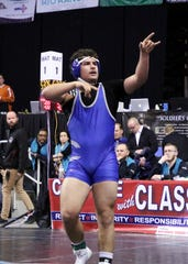 Carlsbad's RJ Baca points to the crowd after winning his fifth-place match in the class 5A 182-pound division during the Saturday portion of the 2019 NMAA State Wrestling Championships.
