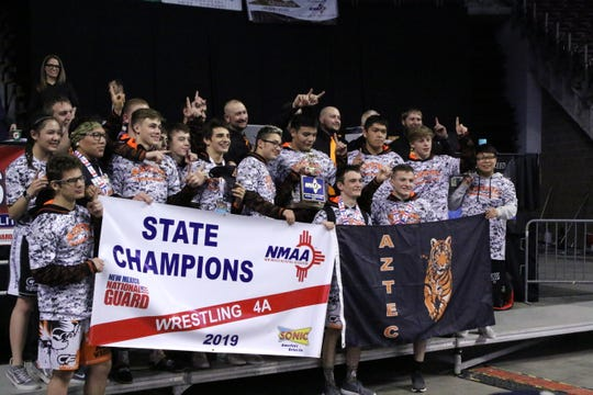 Aztec celebrates winning the Class 4A team title on Saturdayin the 2019 NMAA State Wrestling Championships.