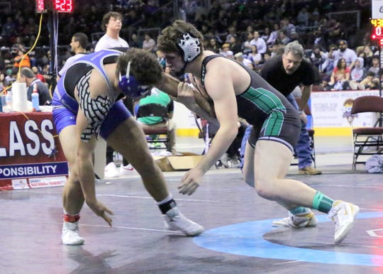 Farmington's Zack Small charges Carlsbad's RJ Baca during the Saturday portion of the 2019 NMAA State Wrestling Championships.