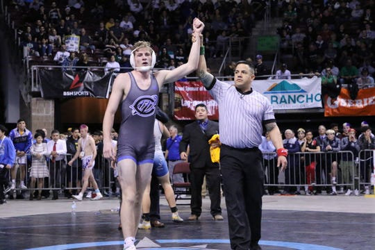Carlsbad's Mason Box has his hand raised after winning the New Mexico state wrestling title in the Class 5A 152-pound division on Feb. 23, 2019.