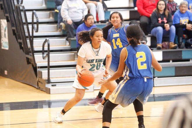 Navajo Prep's Aiona Johnson drives toward the paint against Zuni during Saturday's District 1-3A game at the Eagles Nest in Farmington. Visit daily-times.com to see the latest sports photo galleries and video highlights.