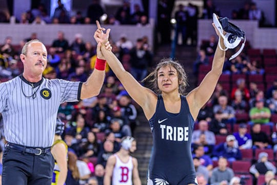 Palm Springs' Cindy Zepeda has her arm raised during her semifinal win Saturday  Rabobank Arena in Bakersfield. She went on to win the desert's first ever CIF girls' wrestling state title.