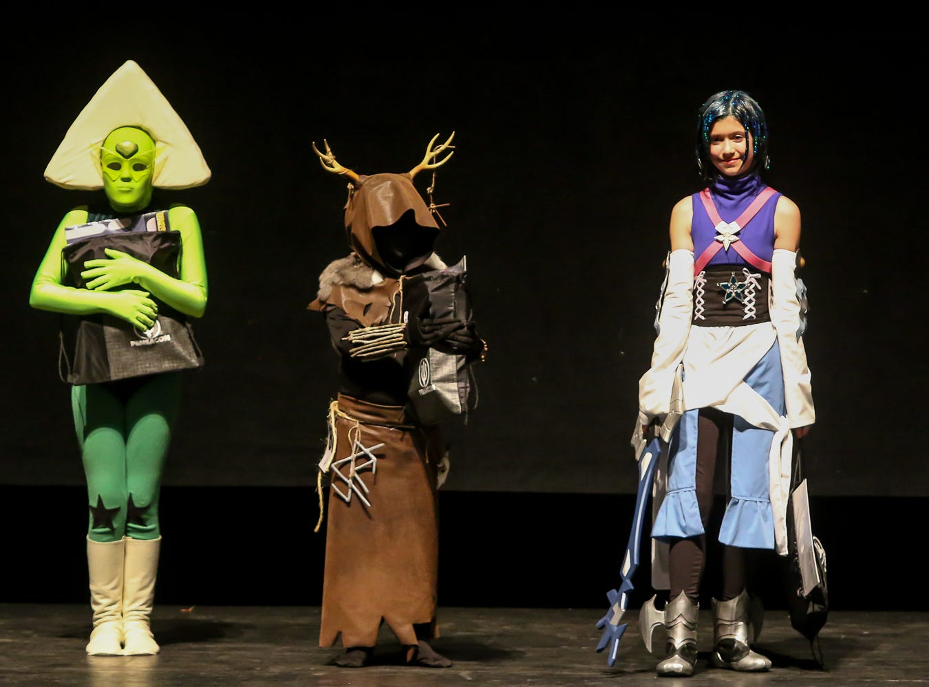 The top three winners in the Youth Division of the Pensacon cosplay contest presented by McGuire's Irish Pub at the Saenger Theatre on Saturday, February 23, 2019. No specific order was awarded.