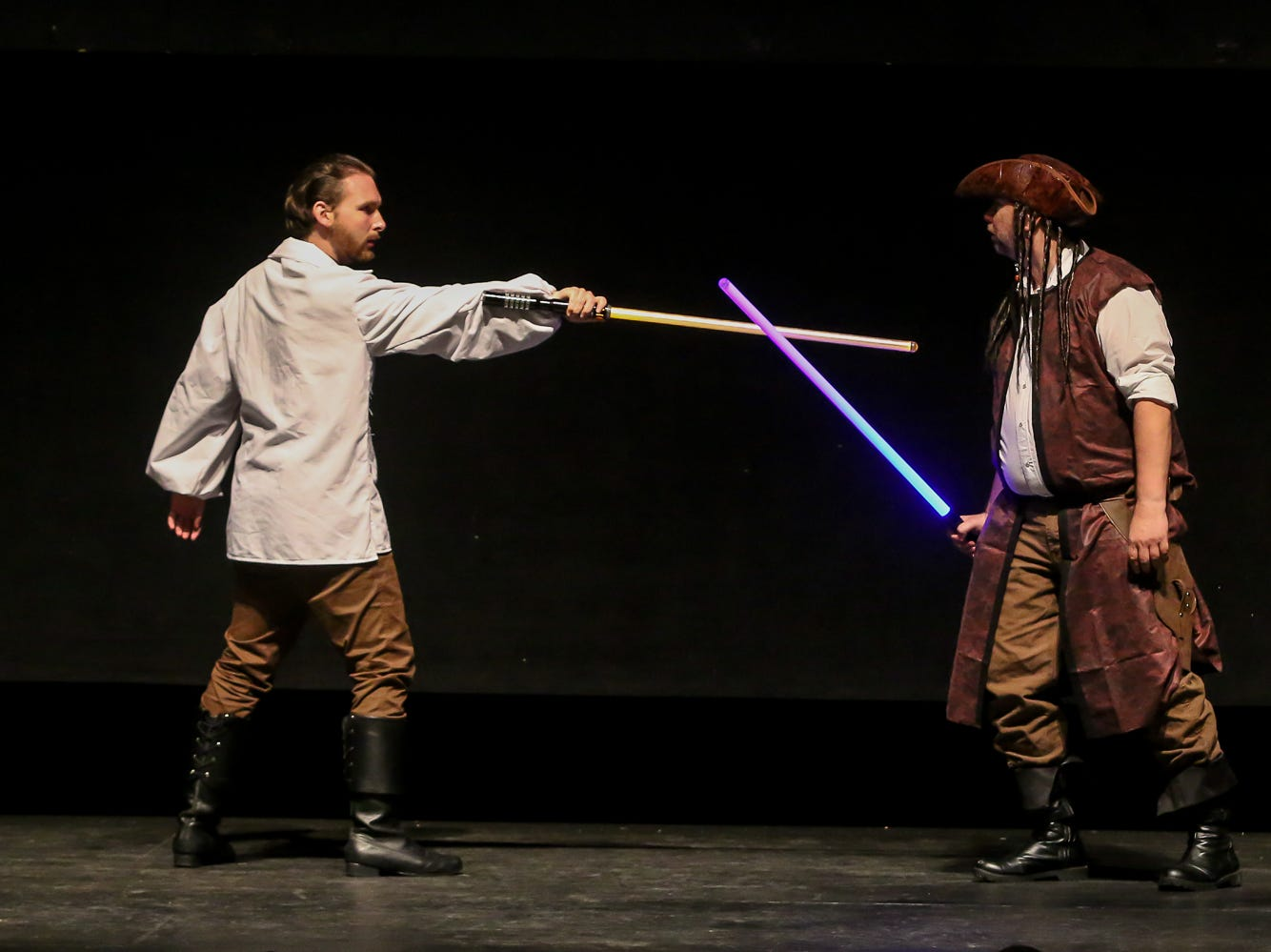 Gulf Coast Lightsaber Training performs during the Pensacon cosplay contest presented by McGuire's Irish Pub at the Saenger Theatre on Saturday, February 23, 2019.