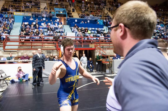 Littlestown's Jason Penton is congratulated by head coach Charles Walls after defeating Eastern Lebanon's Trey Donmoyer during a 182-pound championship bout at the District 3 wrestling championships at Hersheypark Arena Saturday, February 23, 2019.
