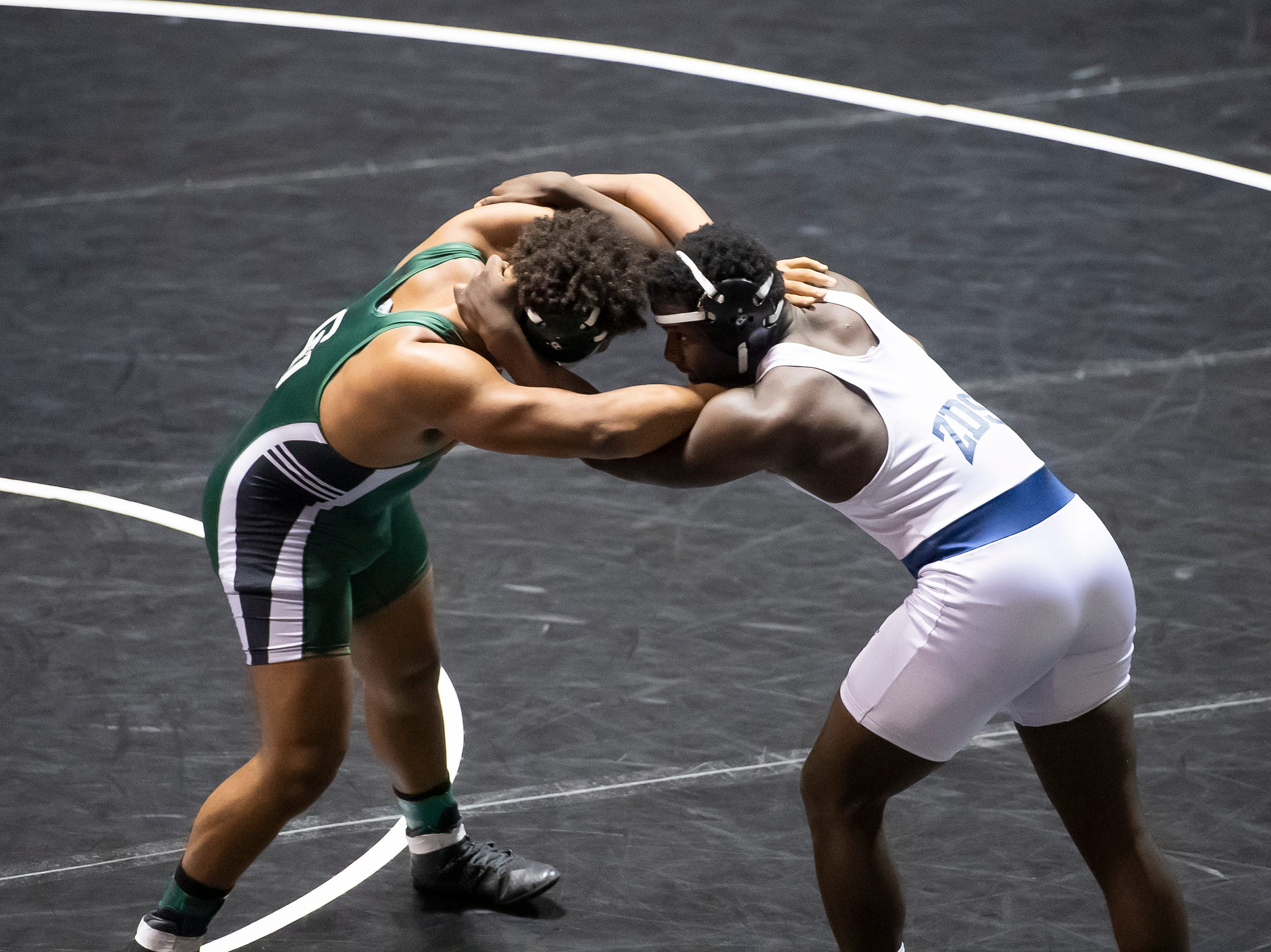 Dallastown's Jamal Brandon, right, wrestles Central Dauphin's Marques Holten during a 220-pound championship bout at the District 3 wrestling championships at Hersheypark Arena Saturday, February 23, 2019. Brandon won by fall 7:48.