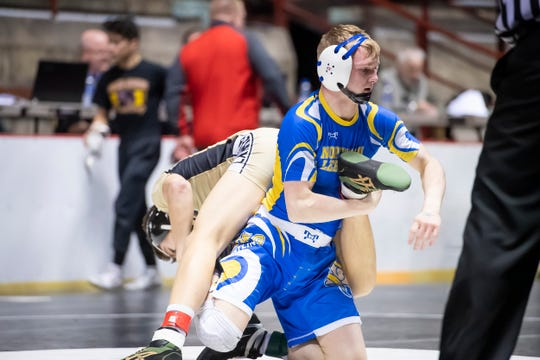 Northern Lebanon's Colin Leonard, right, wrestles Biglerville's Eli Tuckey during a 132-pound championship bout at the District 3 wrestling championships at Hersheypark Arena Saturday, February 23, 2019. Leonard won by decision 8-1.